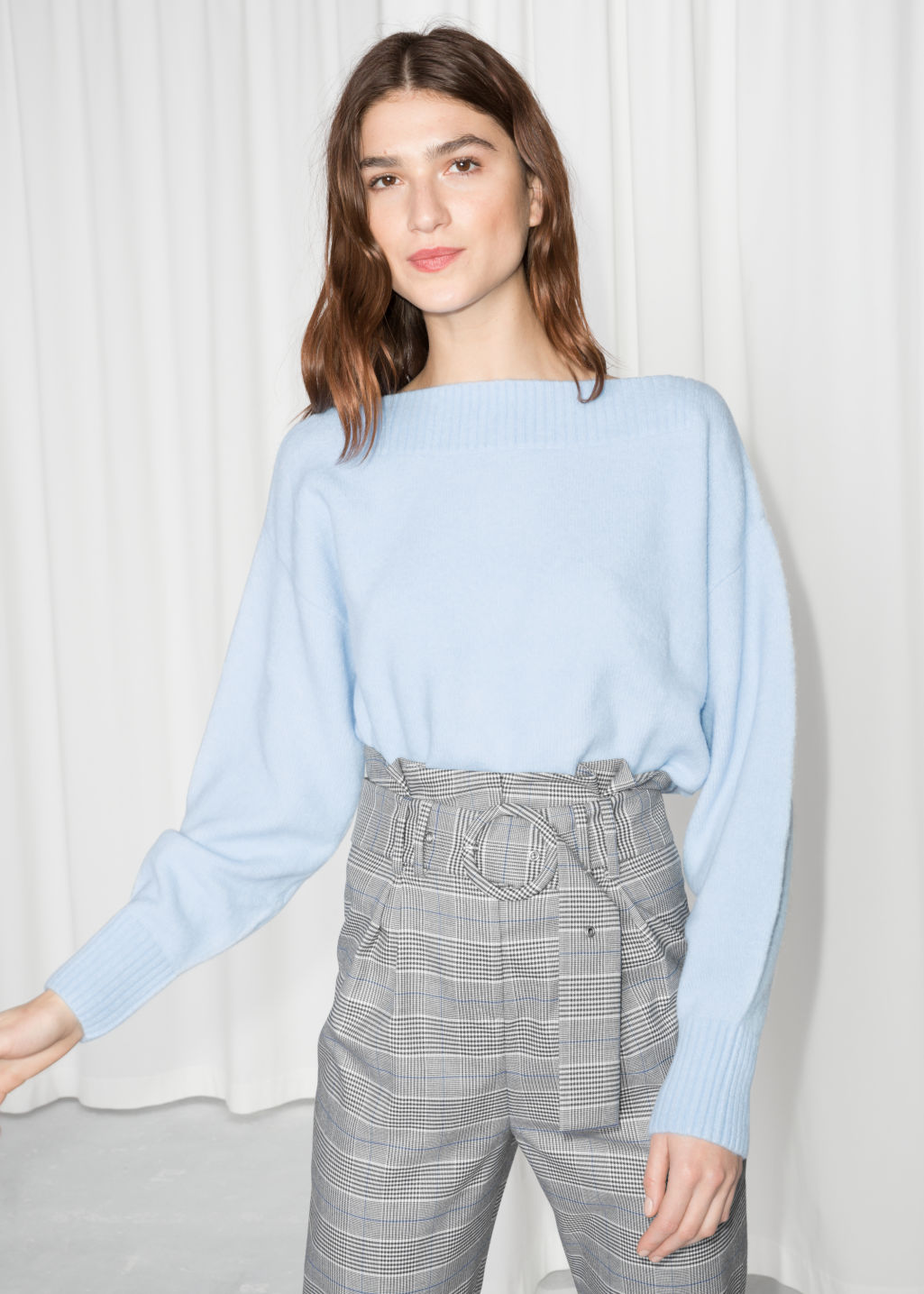 Model front image of Stories cropped boatneck sweater in blue