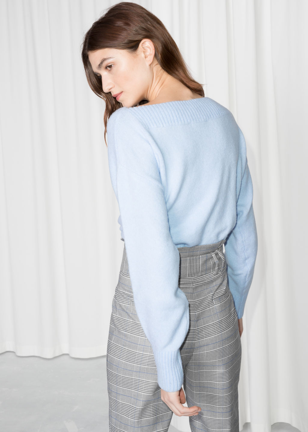 Model back image of Stories cropped boatneck sweater in blue