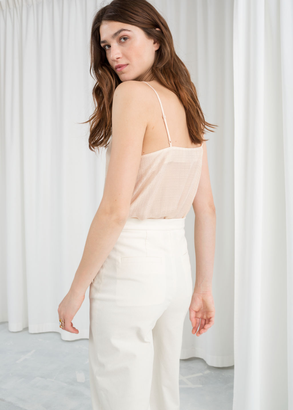 Model back image of Stories v-neck jacquard tank in beige