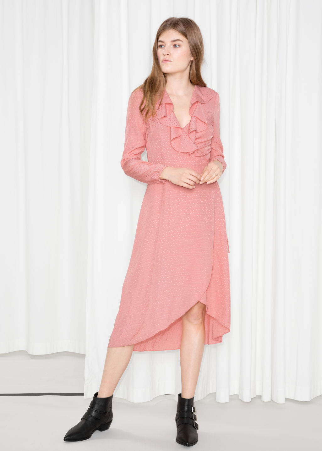Model front image of Stories ruffle tie wrap dress in pink