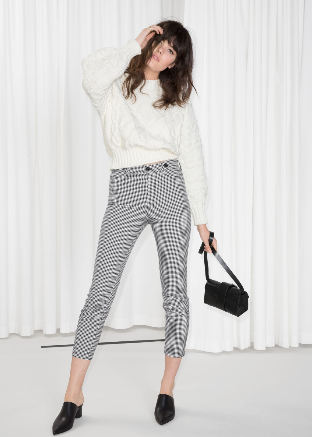 Model front image of Stories gingham trousers in black