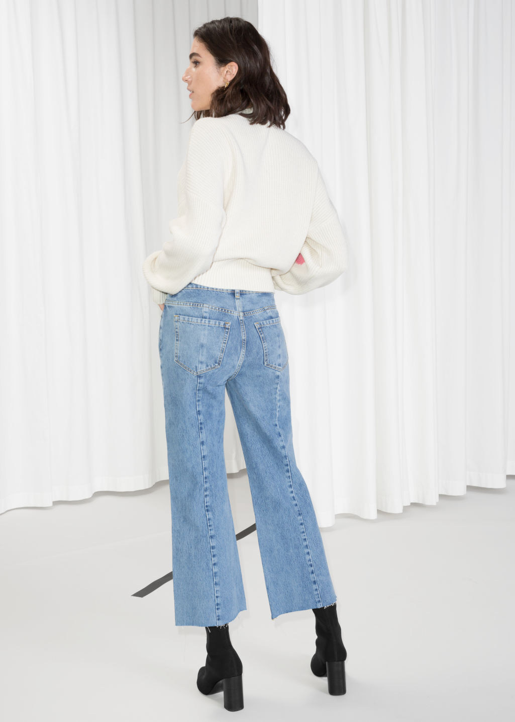 Model back image of Stories cropped flare jeans in blue