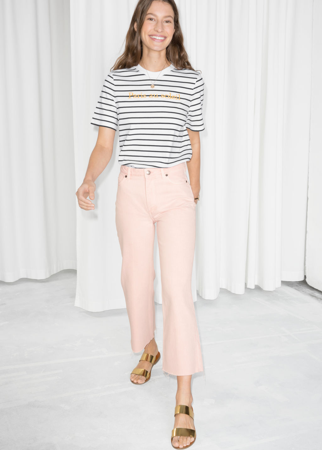 Model front image of Stories cropped flare jeans in pink