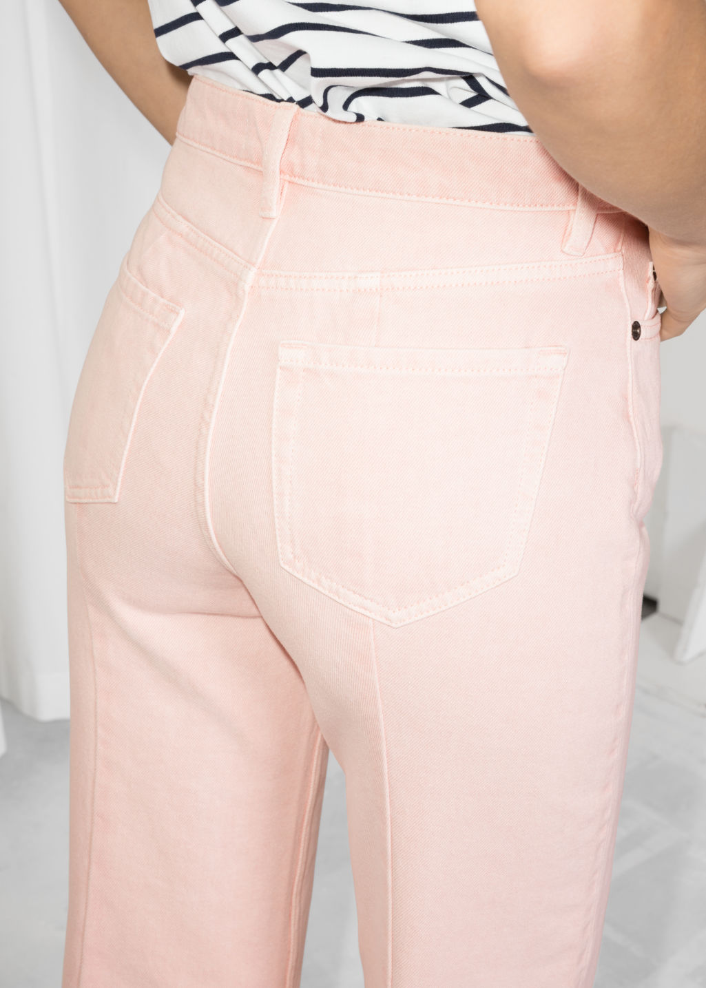 Model back image of Stories cropped flare jeans in pink