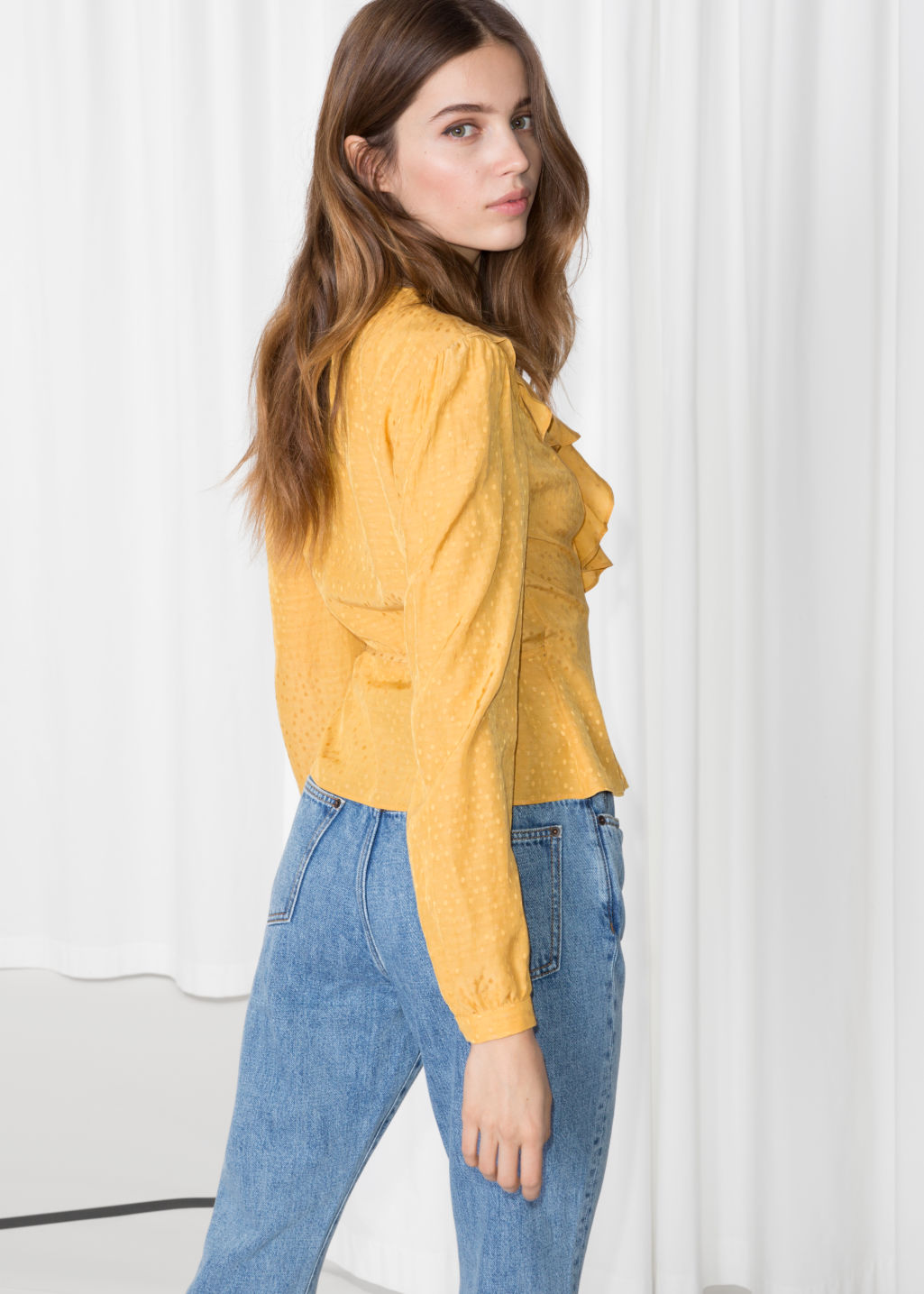Model back image of Stories ruffle wrap blouse in yellow