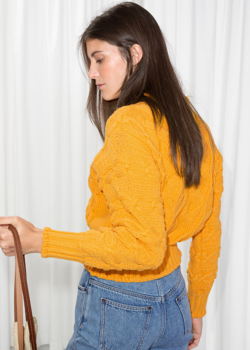 Model back image of Stories chunky knit sweater in yellow