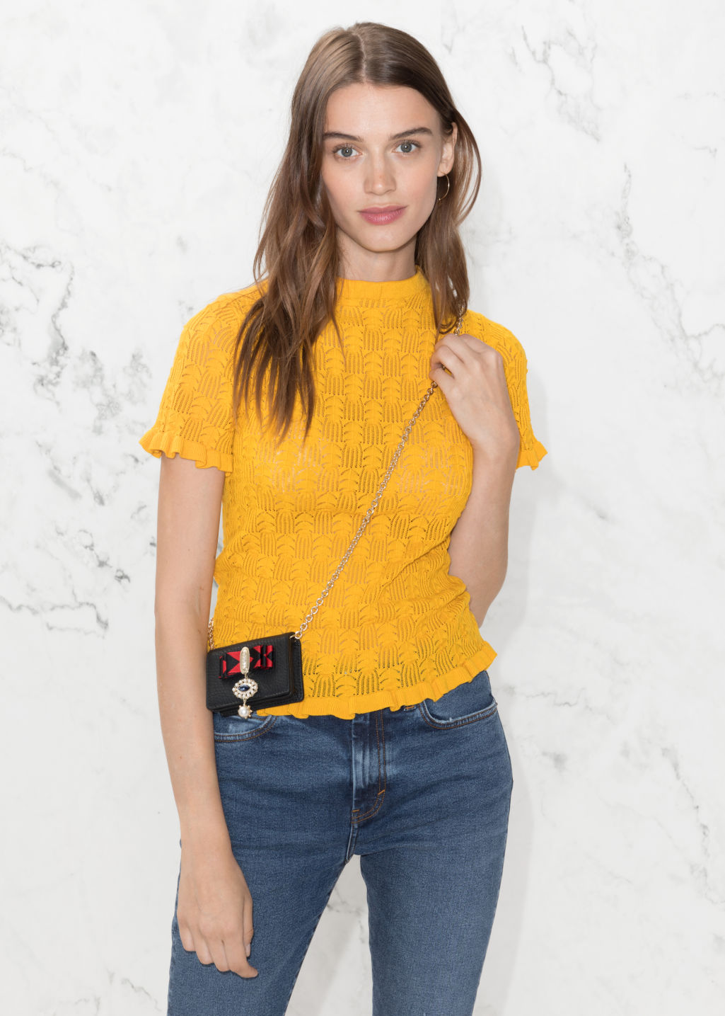 Model front image of Stories ruffle knit top in yellow