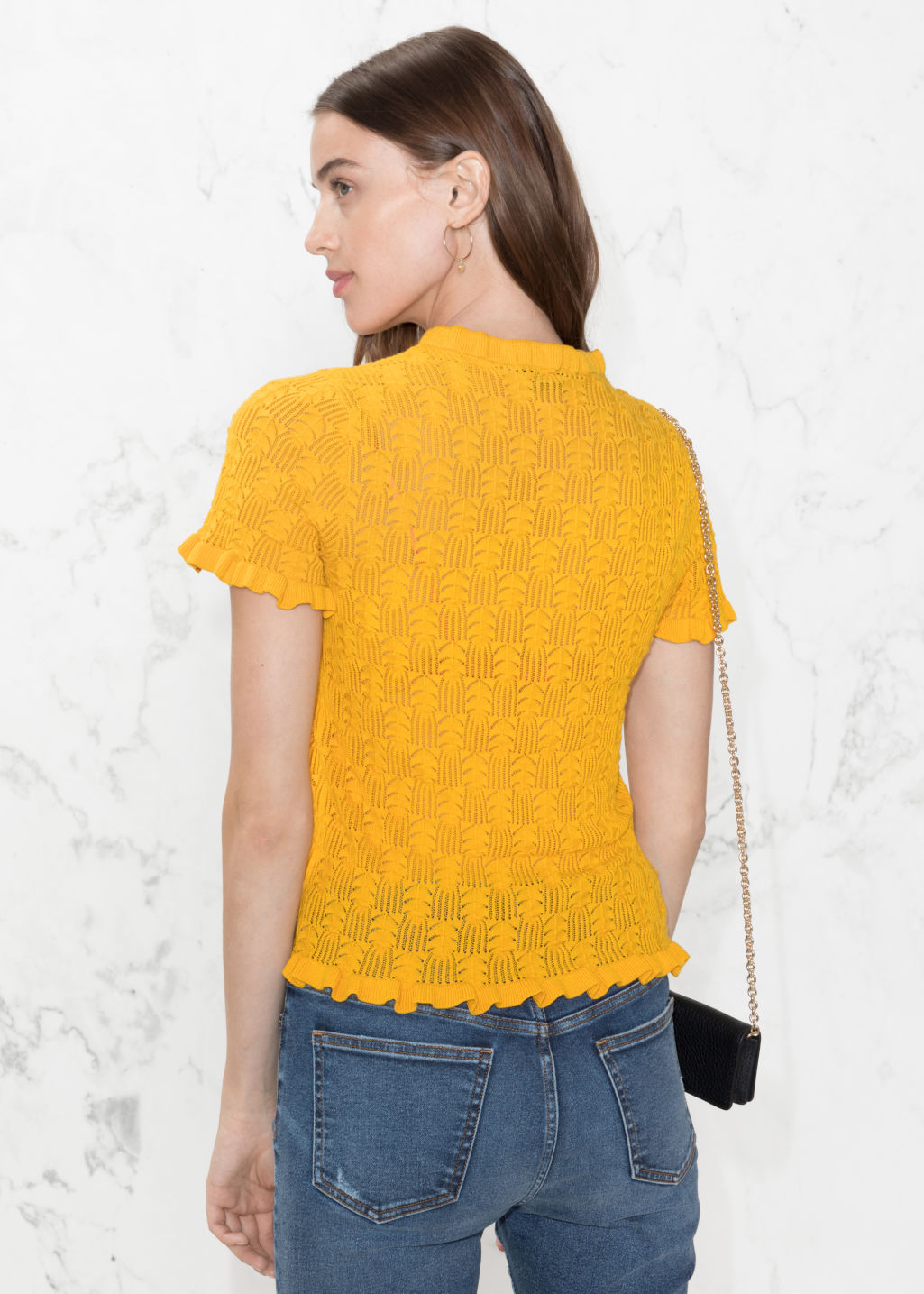 Model back image of Stories ruffle knit top in yellow