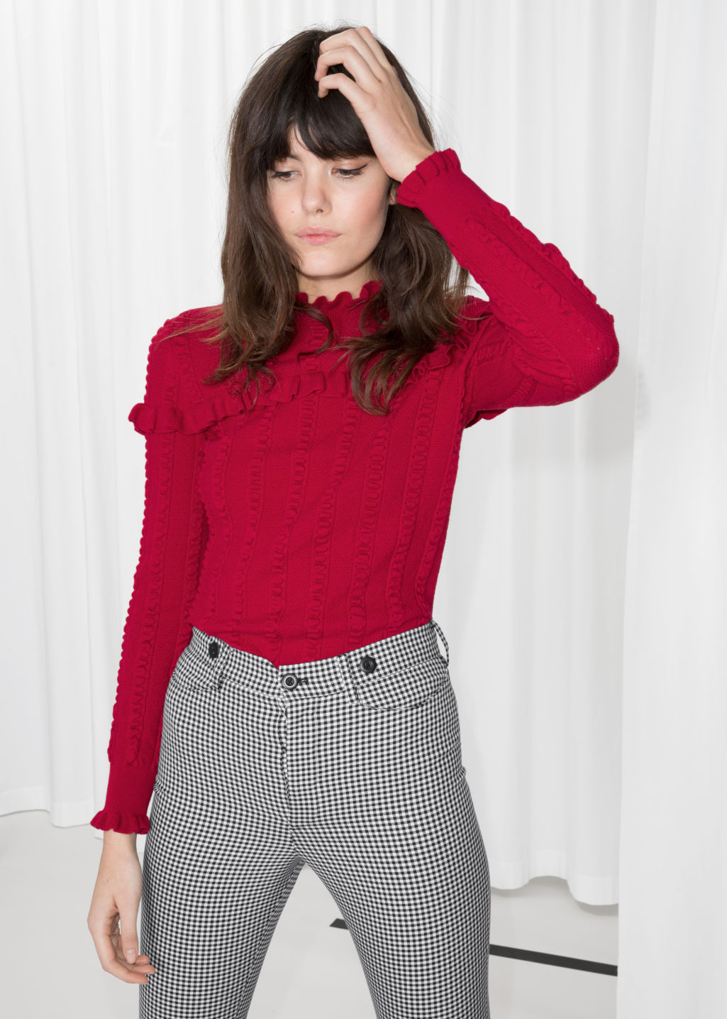 Model front image of Stories ruffle knit sweater in red