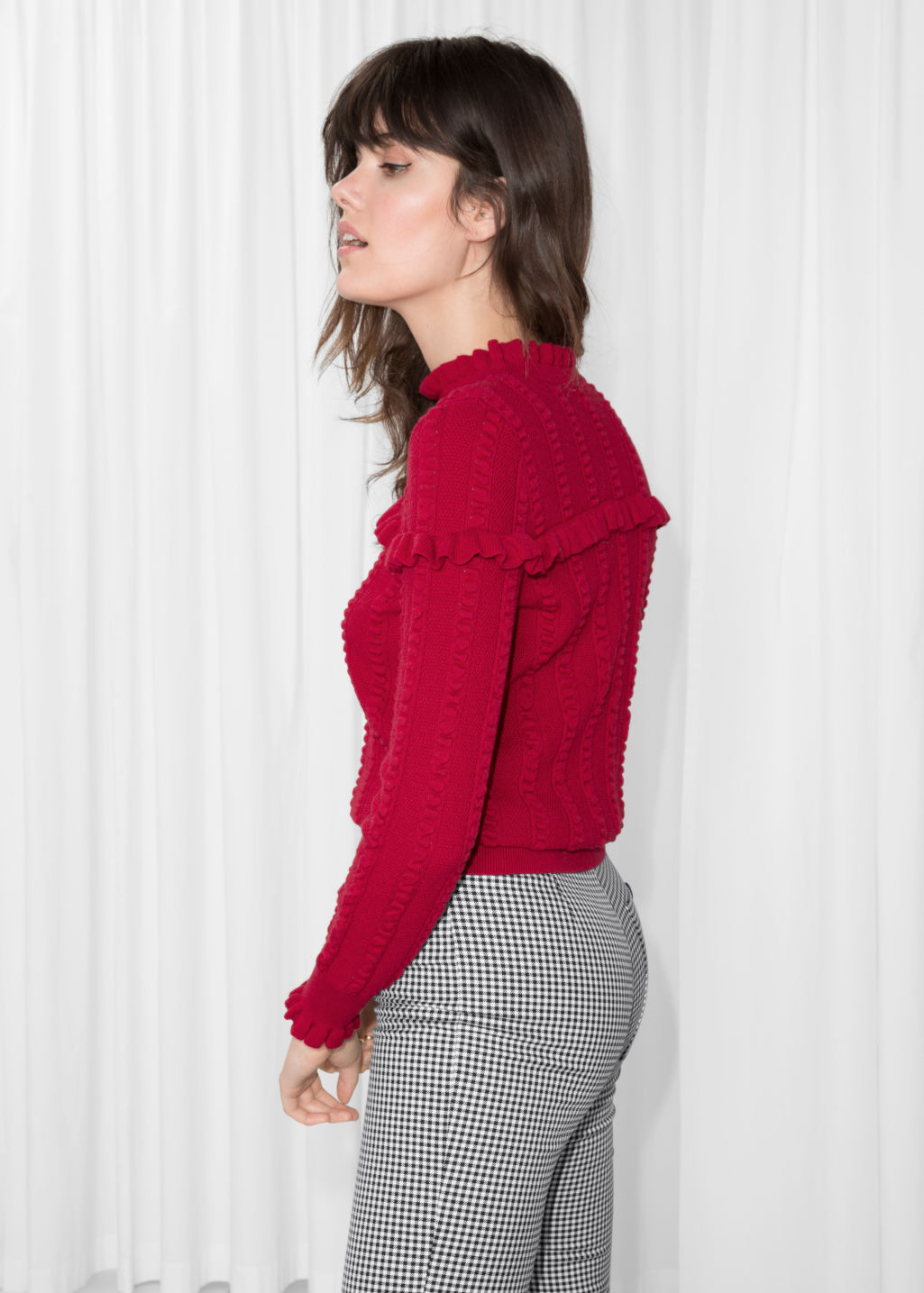 Model back image of Stories ruffle knit sweater in red