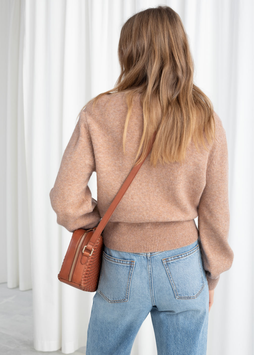 Model back image of Stories cropped sweater in beige