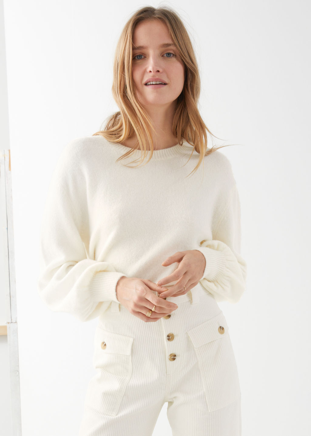 Model front image of Stories cropped sweater in white