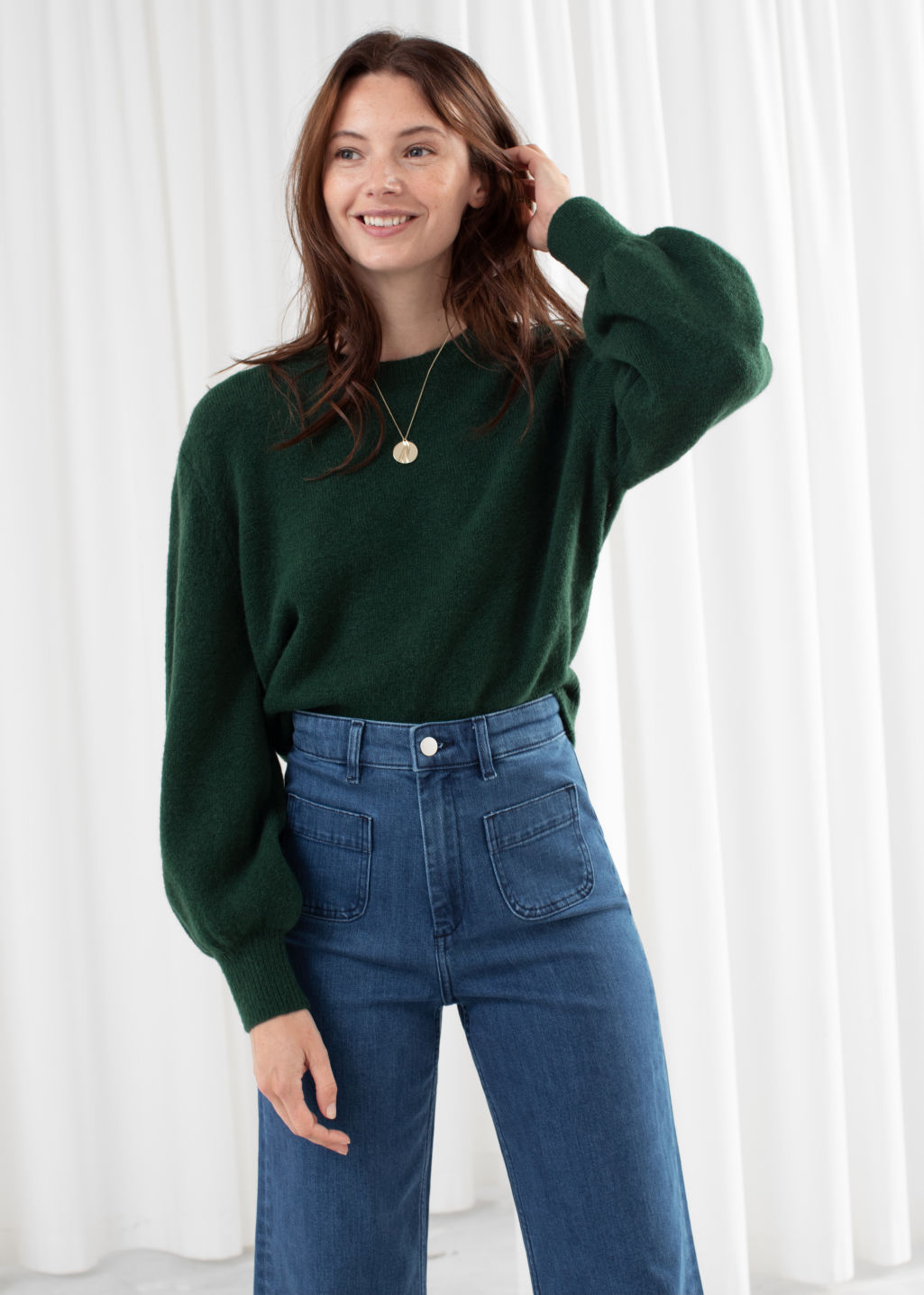 Model front image of Stories cropped sweater in green