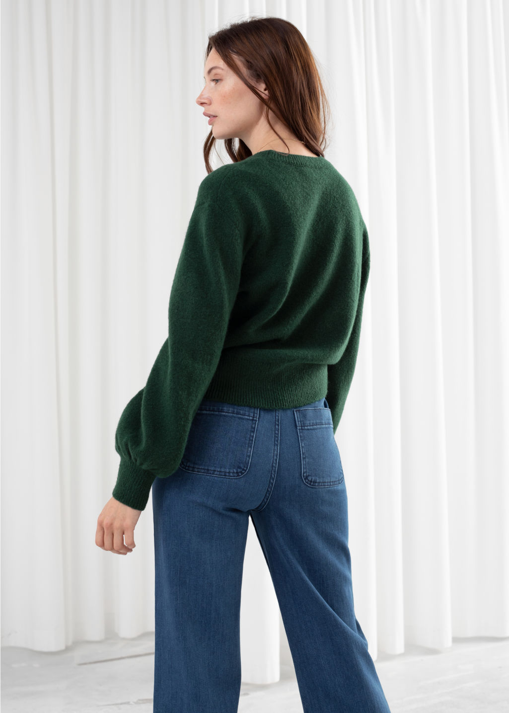 Model back image of Stories cropped sweater in green