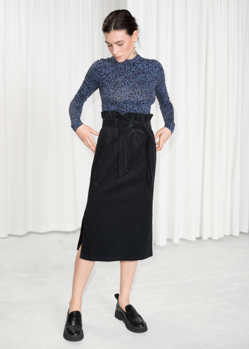 Model front image of Stories belted corduroy skirt in black