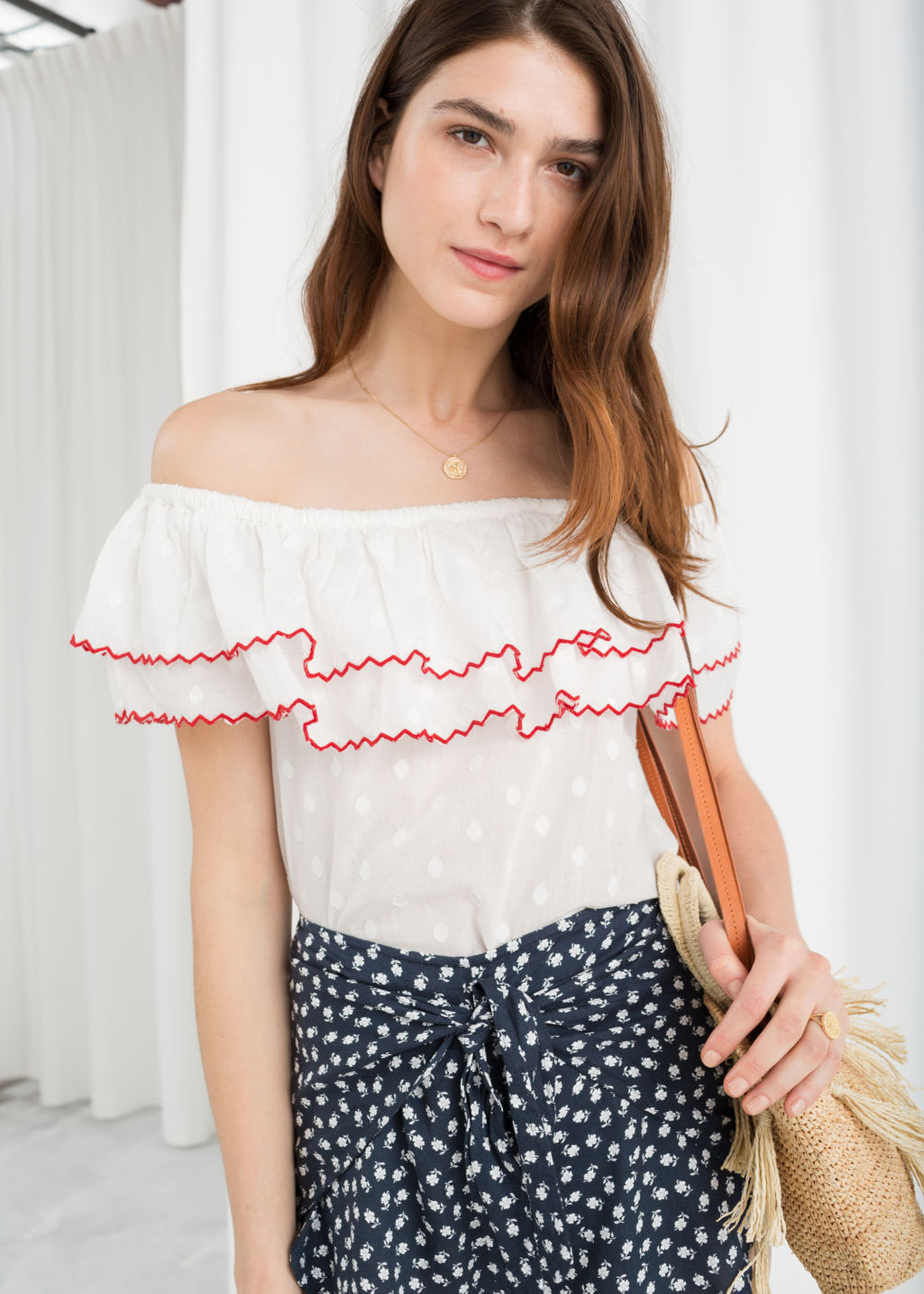 Model front image of Stories ruffled off shoulder top in white