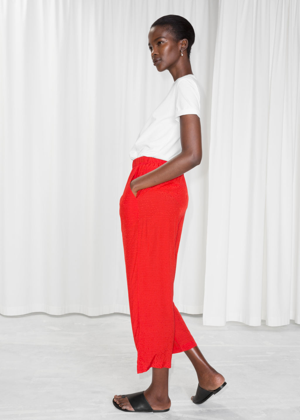 Model back image of Stories jacquard dot print trousers in red