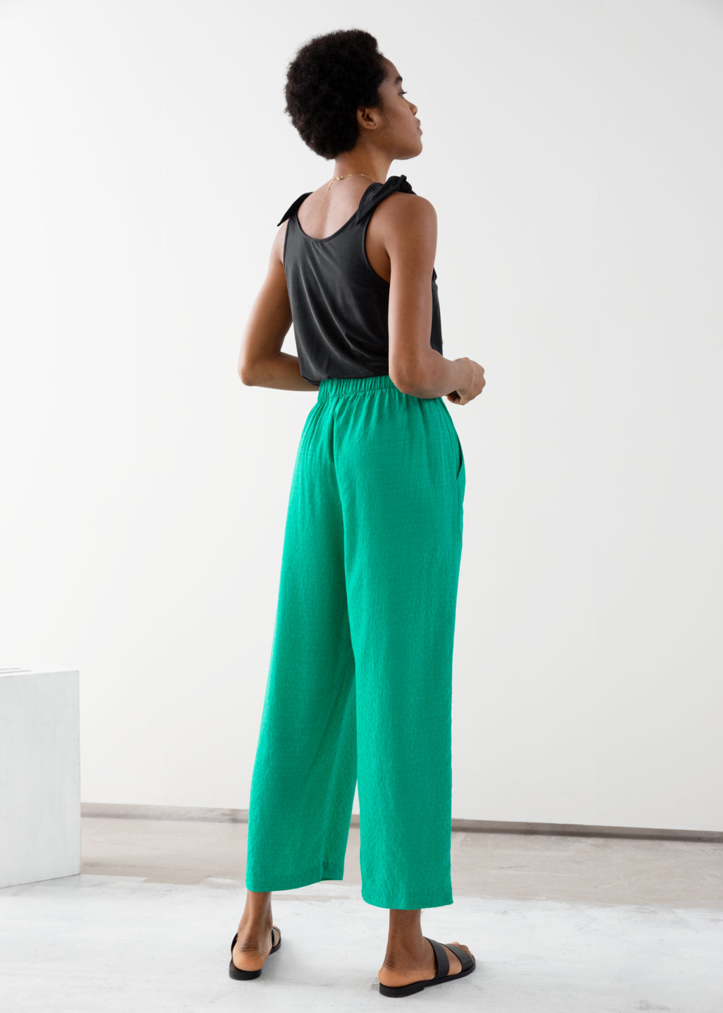 Model back image of Stories jacquard dot print trousers in green