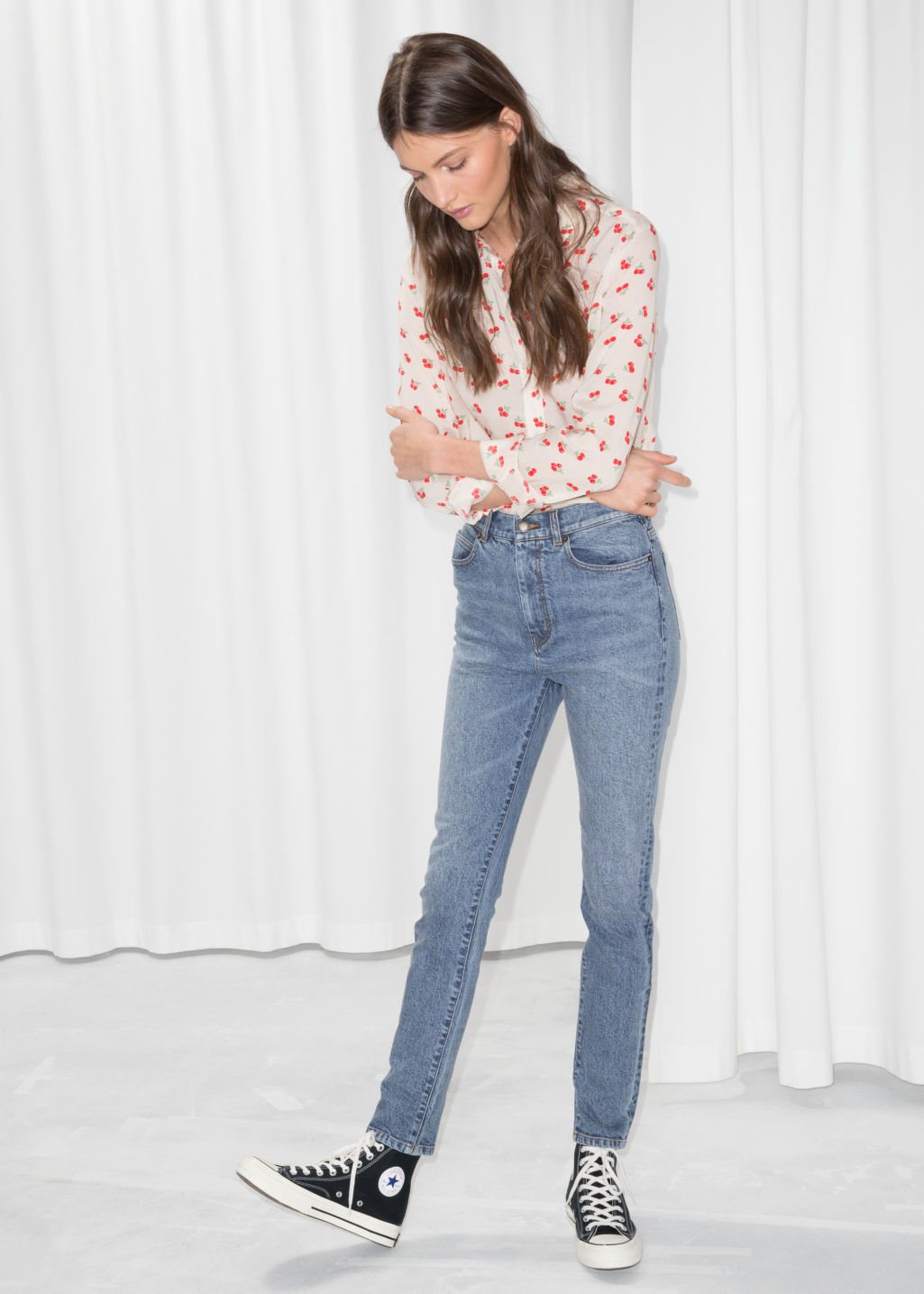 Model front image of Stories high rise slim jeans in blue