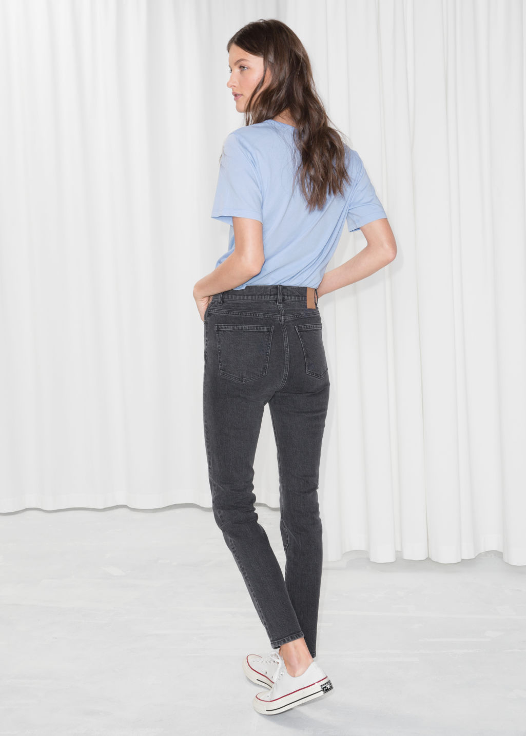 Model back image of Stories high rise slim jeans in black