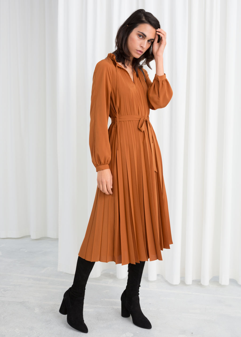 Model front image of Stories printed pleated midi dress in orange
