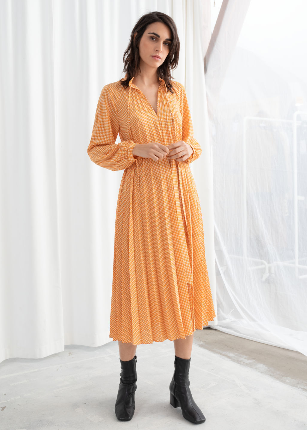 Model front image of Stories pleated midi dress in yellow