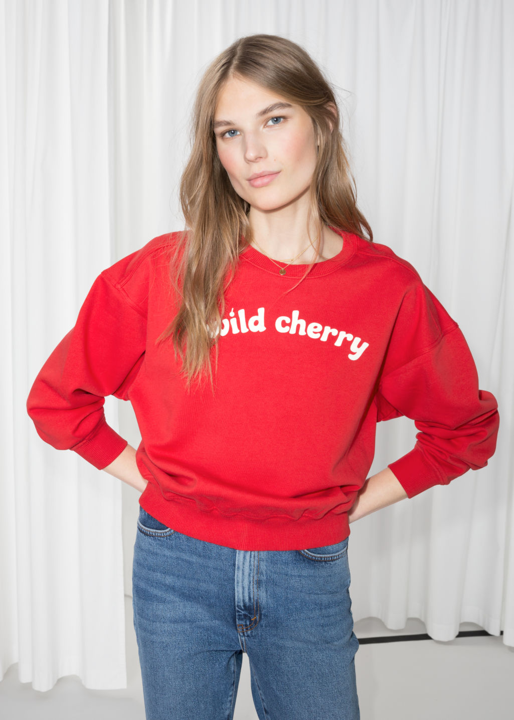 Model front image of Stories wild cherry pullover in red