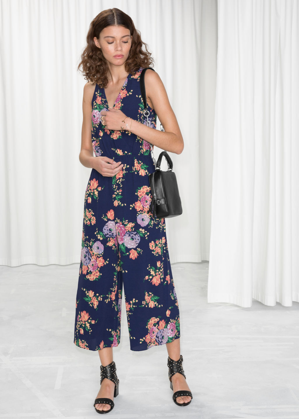 Model front image of Stories open back culotte jumpsuit  in blue