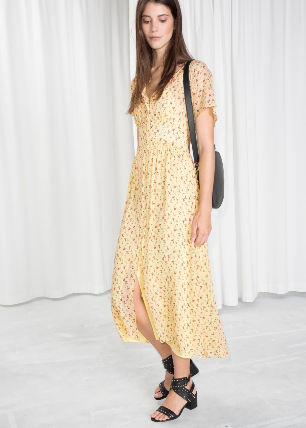 Model front image of Stories floral print midi dress in yellow