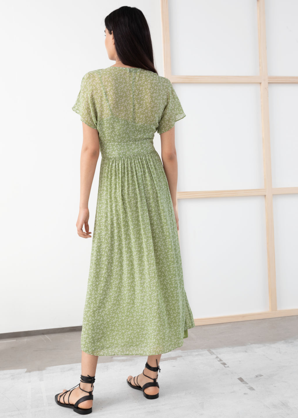 Model back image of Stories floral print midi dress in green