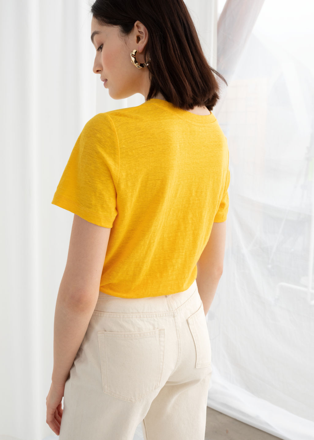 Model back image of Stories classic crewneck tee  in yellow