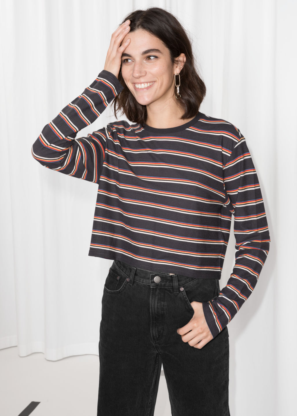 Model front image of Stories cropped long sleeve shirt in black