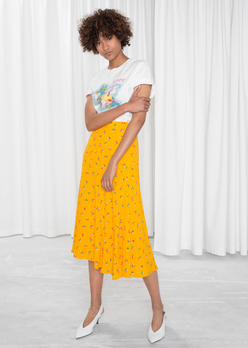Model front image of Stories asymmetrical floral midi skirt in yellow