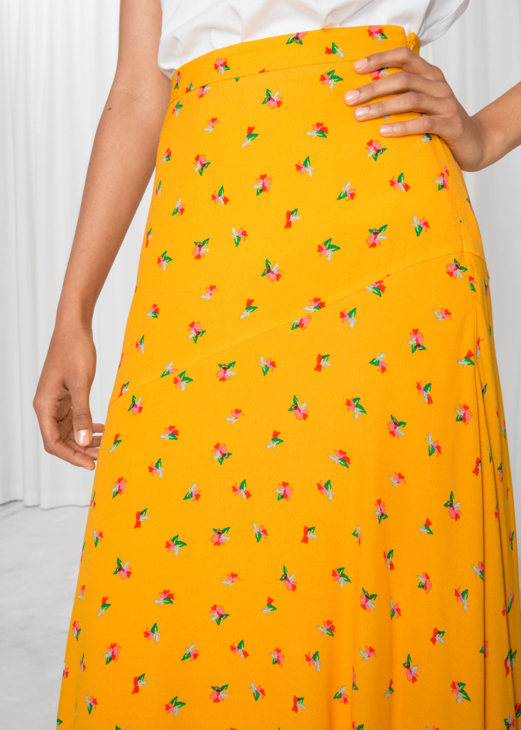 Model back image of Stories asymmetrical floral midi skirt in yellow