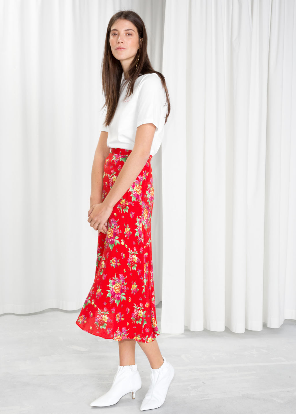 Model front image of Stories asymmetrical floral midi skirt in red