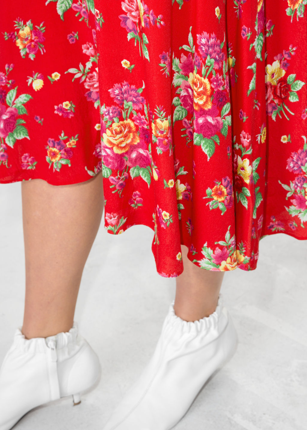 Model back image of Stories asymmetrical floral midi skirt in red