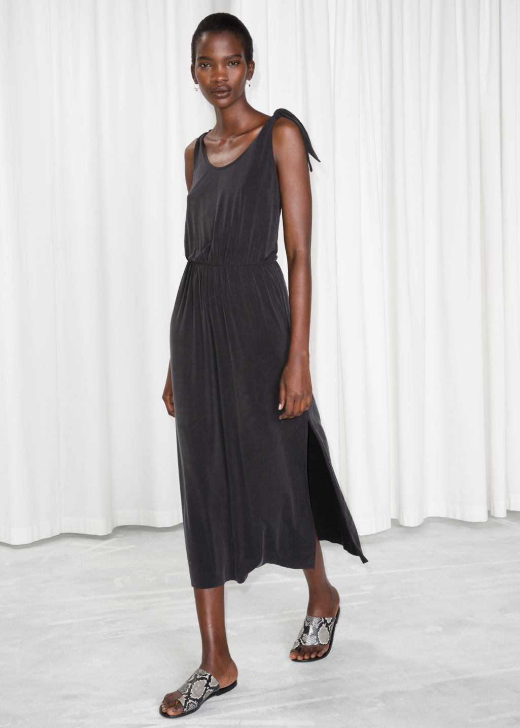Model front image of Stories ruched waist midi dress in black