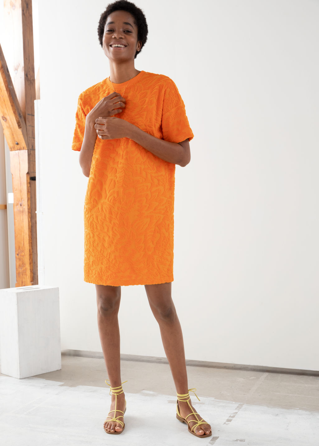 Model front image of Stories velour t-shirt dress in orange