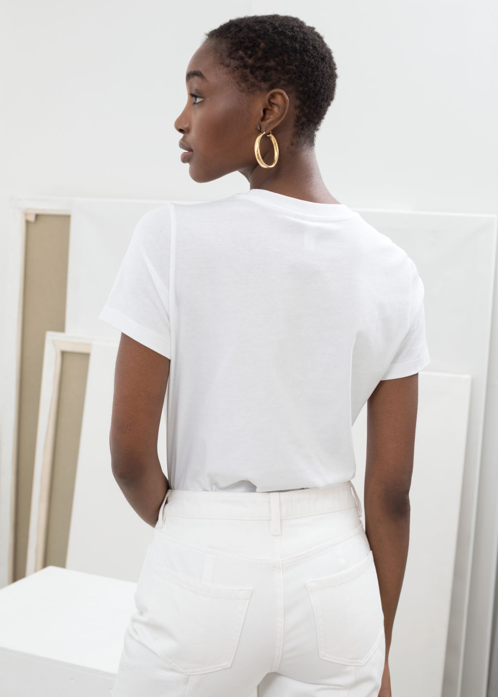Model back image of Stories jumbo stripe tee in white