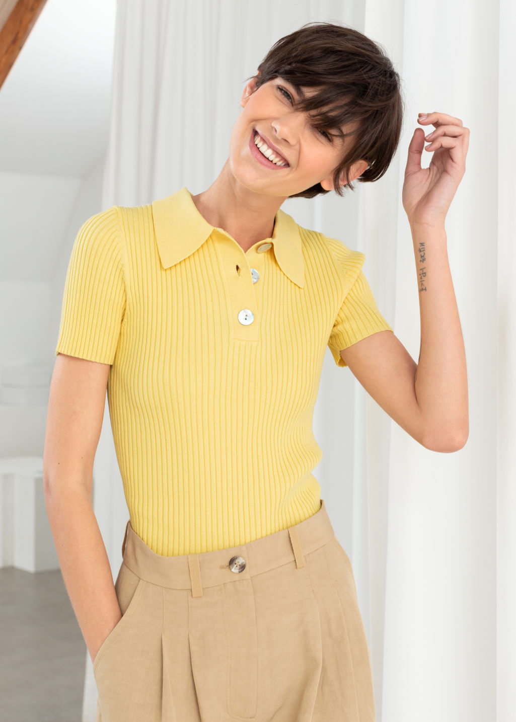 Model front image of Stories knit polo top  in yellow