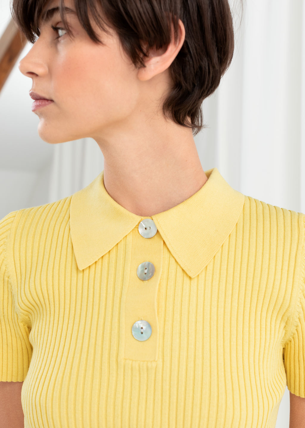 Model back image of Stories knit polo top  in yellow