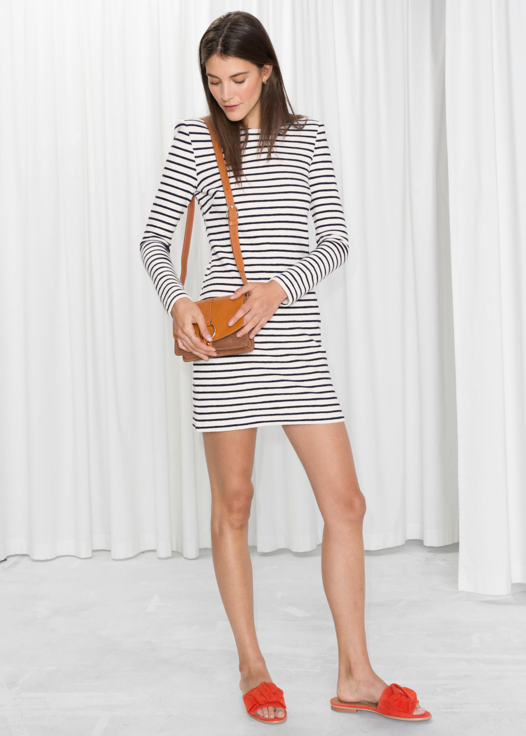 Model front image of Stories striped mini dress in white