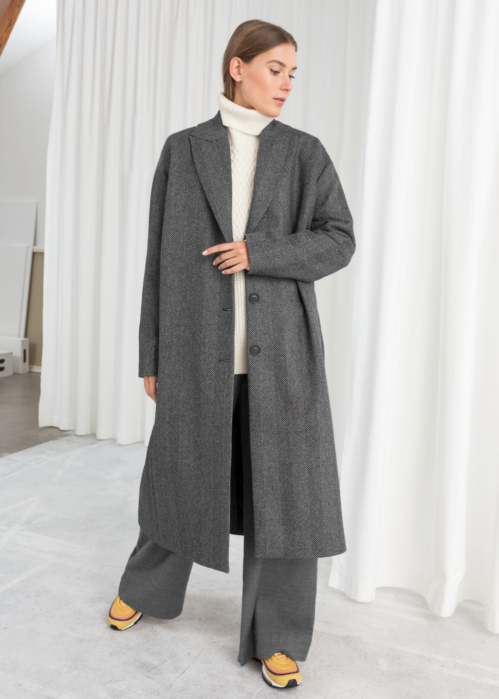 Model front image of Stories herringbone wool blend coat in black