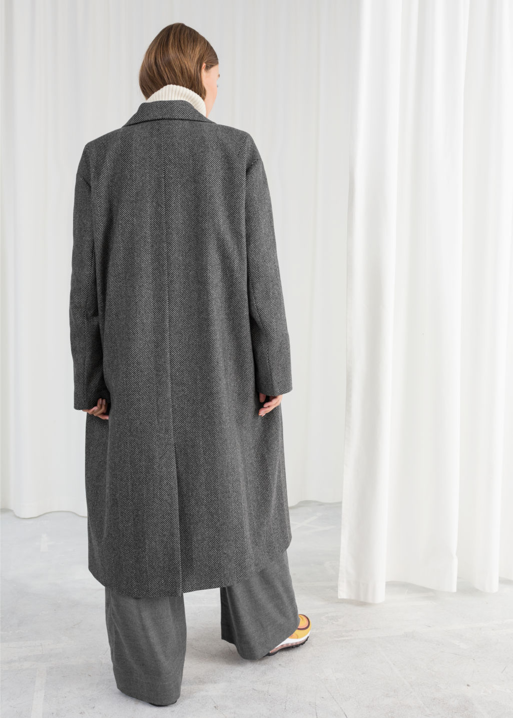 Model back image of Stories herringbone wool blend coat in black
