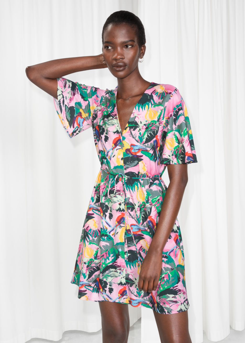Model front image of Stories tropical print dress in pink
