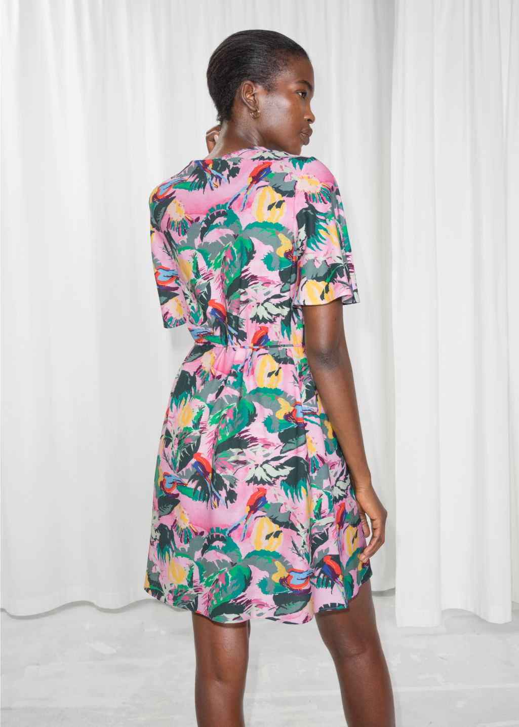 Model back image of Stories tropical print dress in pink