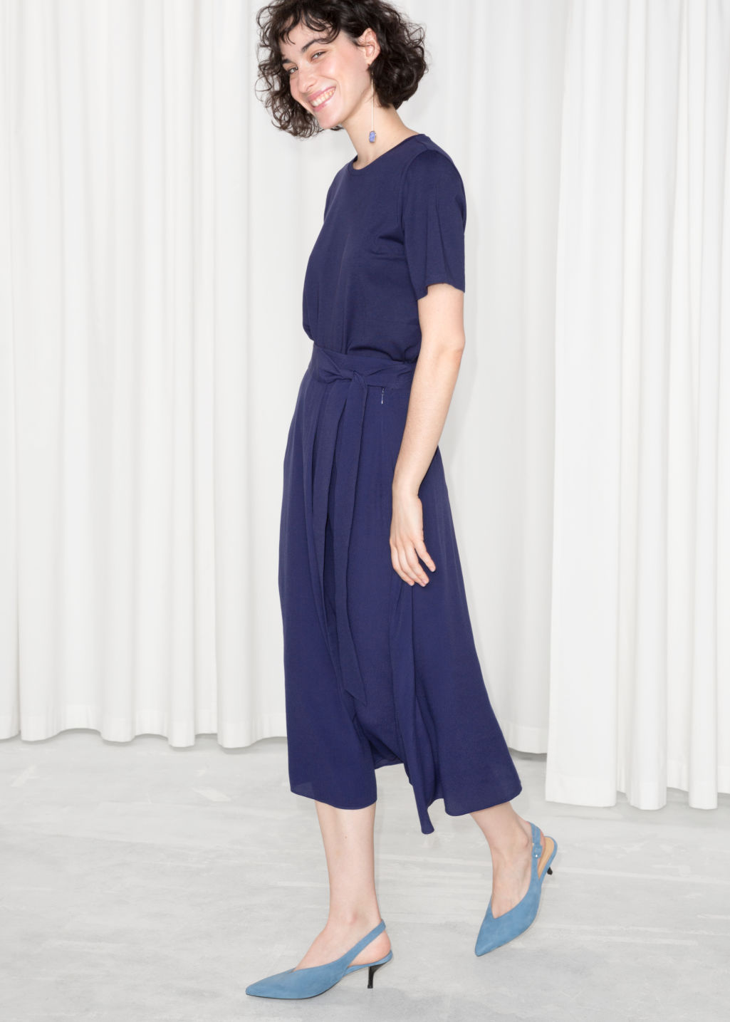 Model front image of Stories belted midi skirt in blue
