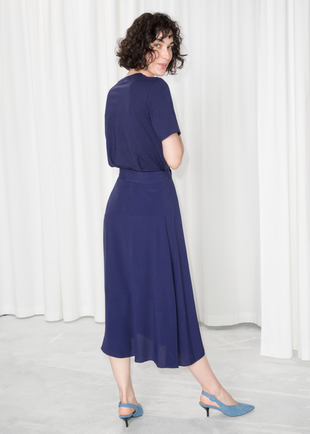Model back image of Stories belted midi skirt in blue