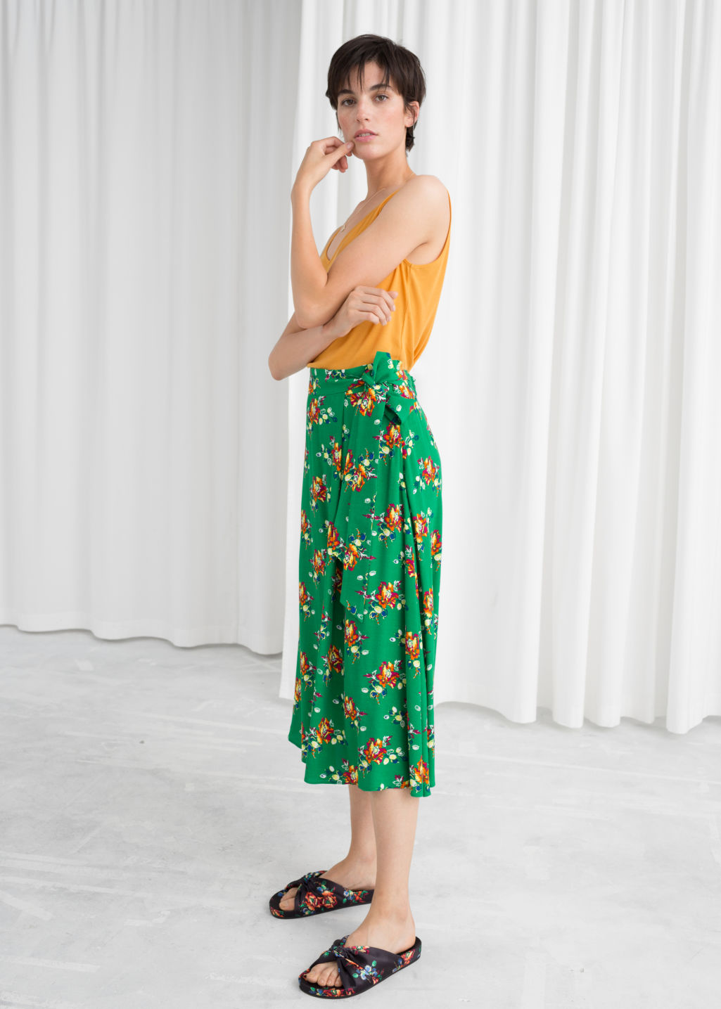 Model front image of Stories belted midi skirt in green