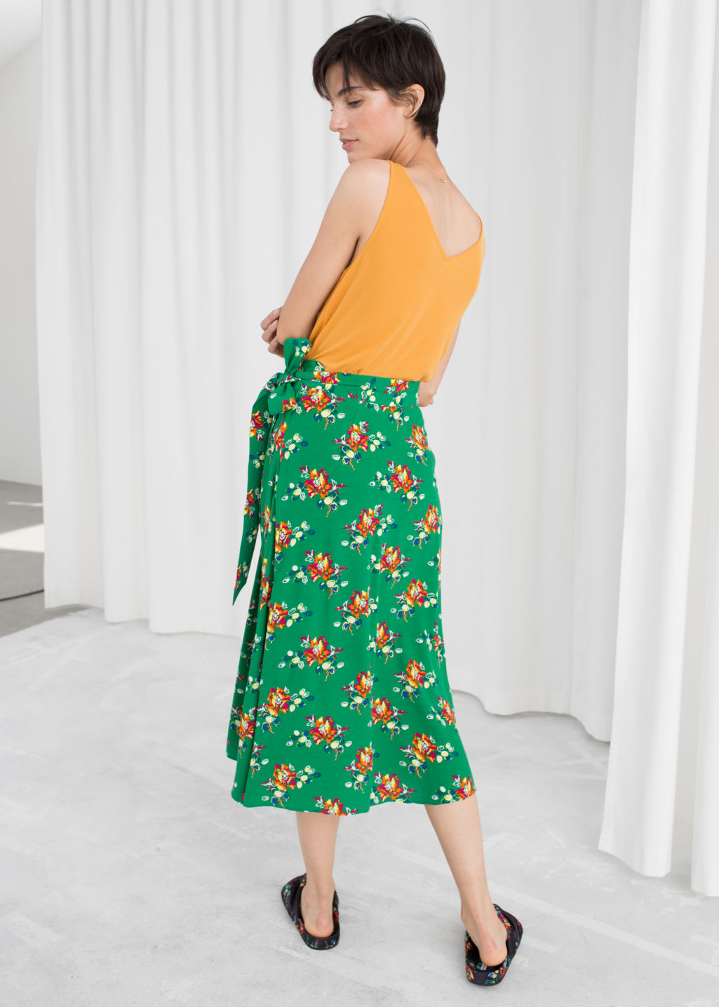 Model back image of Stories belted midi skirt in green